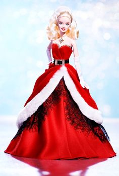 """2007 Happy Holiday Barbie  released: 6/1/2007  code: K7958  The 2007 Holiday™ Barbie® doll captures all the warmth and magic of the season in an adorable Santa-inspired look, as only Barbie® doll could do so well. Dressed in a very merry strapless crimson gown, our """"Miss Claus"""" is both exceedingly gorgeous and undeniably festive. One thing's for sure: this holiday stunner will be making spirits bright in 2007 and beyond!"""