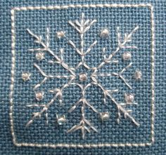 Snowflake 2, designed by @Lesley Bousbaine, tintocktap blogger for Snowflakes in the Snow 15-sided biscornu.