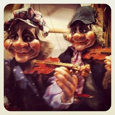 Violins everywhere! Even on the Czech puppets. #travel #prague