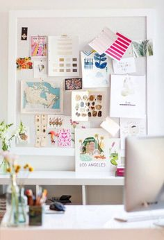This home office is beautiful and I love the natural tones with pops of pink