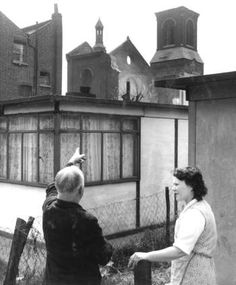 Prefabricated house on Royal Street. Built after bomb damage to houses in the area, with bomb damaged Holy Trinity Church in th background. South London, New South, Cycling In London, Elephant And Castle, 1940s Home, Local Studies, London History, Prefabricated Houses, Images And Words