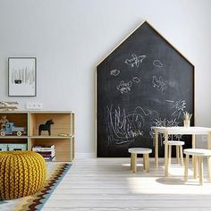 large chalk board in kid's area - table, low storage bookshelf for storage. family room ideas