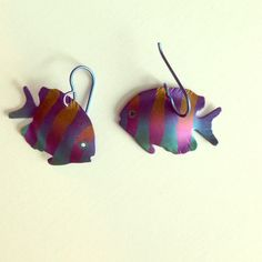 Adorable Striped Fish Earrings Striped Fish Earrings with orange stripes. Has a multicolored background. Never worn. Jewelry Earrings