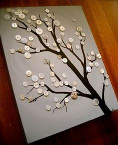 Button tree. There are other examples on this website, too. Plus, I saw a neat wall with the canvases painted different colors for interest.