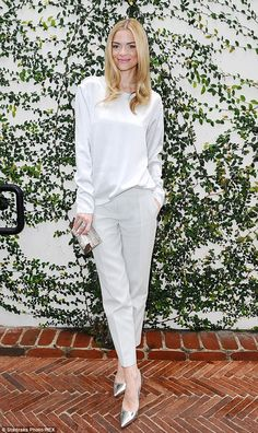 Looking all-white: Jaime King donned a white silk top and smart trousers with metallic acc...