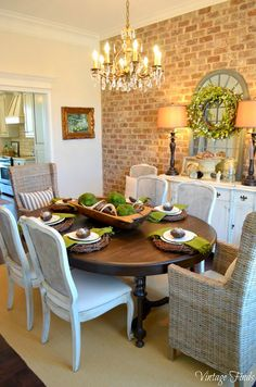 love the black/brown table mixed with white chairs and wicker