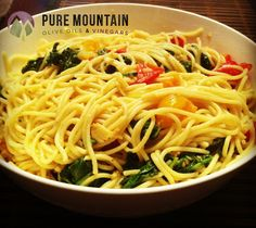 Sicilian Spaghetti with Roasted Tomatoes and Wilted Arugula | Pure Mountain Olive Oil and Vinegars | www.PureMountainOliveOil.com | Pure Mountain's Sicilian Bread Dipping Oil completes this dish wonderfully. The taste of parmesan, without the parmesan, so this recipe is 100% vegan! This will be your new favorite pasta dish in no time. | #vegan #vegetarian #pasta #veganpasta #vegetarianpasta #oliveoil #extravirginoliveoil #pastarecipe #italian #puremountain
