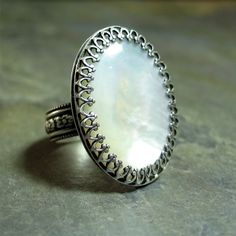 Mother of Pearl Ring, shell ring, white ring, filigree bezel, Sterling Silver, statement ring, cocktail ring - Captured Moonlight. $79.00, via Etsy.