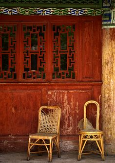 Chairs In Front Of An Old House, Lijiang, Yunnan Province, China