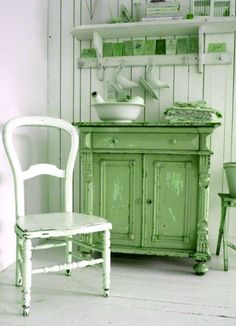 Country style green and white kitchen... this is so pretty.