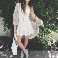Love the effortless look of the white sundress with a large cardigan over it paired with ankle boots and a handbag.