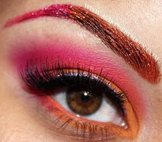 Orange and pink eyeshadow with matching brows