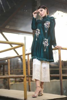 Green velvet top with embroidery and accessories, and velvet brocade yoke, with feather and crystal finishing on hemline. Choose from cigarette trousers, straight trousers, boot cut trousers or culottes. Pakistani Party Wear, Pakistani Dresses, Stylish Dresses, Fashion Dresses, Velvet Dress Designs, Long Tunic Tops, Pakistan Fashion, Medieval Dress, Embroidered Clothes