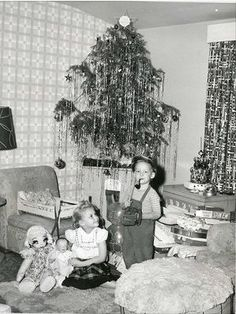 Vintage Christmas photo, 1950's. This is so my Christmas experience! Small tinseled tree on a table to make it look more grand. Everything was grand at Christmas!!