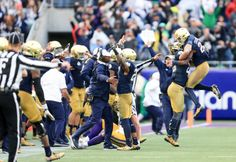 Jan 1, 2018; Orlando, FL, USA; The Notre Dame Fighting Irish bench celebrates after a turnover on downs late in the fourth quarter against the LSU Tigers in the 2018 Citrus Bowl at Camping World Stadium. Mandatory Credit: Matt Stamey-USA TODAY Sports