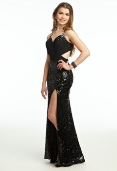 """To be a beautiful woman you must show confidence and in this powerful Long Paige """"little black dress"""" you'll convey all of the confidence in the world and look amazingly HOT when doing so! Brushing the floor, this all sequin formal dress is a stunning pic to be worn as a prom dress, cocktail dress, or even as a guest of wedding dress. From an all beaded halter neckline to a cut out back and beaded bodice to an all sequin skirt this dress is blingtastic and it's truly amazing!"""