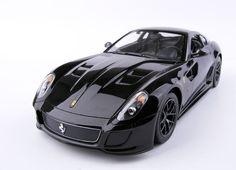 Ferrari 599 GTO Black - RASTARAdjustable Front Wheel AlignmentWorking Headlight and TaillightTrigger Type ControllerDetail Exterior & InteriorGlass Exterior PaintFunctions:-R/C scale: 1:14-Full functi