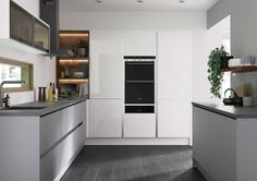 First Impressions Halton in Gloss White and Super Matt Grey - The Halton kitchen is ideal for creating an ultra modern look with its clean, neat, flat-profiled design thanks to the truly handleless drawers and cupboards. Using the latest manufacturing technologies, the Halton matt doors achieve a high resistance to stains and marks.