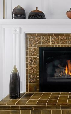 The revival of small-batch art tile has never been more vibrant than in today's revival, as you'll see in the work of three unique artisan tile makers. Craftsman Living Rooms, Craftsman Tile, Craftsman Decor, Craftsman Fireplace, Craftsman Bathroom, Fireplace Art, Fireplace Remodel, Fireplace Design, Fireplaces