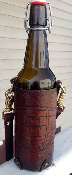 Leather tooled grolsch bottle holder - to BYOB in style! http://www.instructables.com/id/Tooled-Leather-Grolsch-Bottle-Holder/