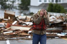 Hurricane Sandy - Brian Hajeski, 41, of Brick, N.J., reacts after looking at debris of a home that washed up the morning after superstorm Sandy rolled through. | latino.foxnews.com | Photo: Associated Press/Julio Cortez