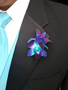 Blue Dandrobium Orchid Boutonniere The suit!! This is either for groom or groomsmen