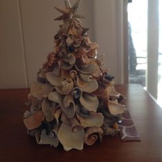 This was made with broken welk shells we call these roses.use a styrofoam tree liquid nails for glue. Start with large at bottom work up. Let dry overnight way. The star is auger shells. Seashell Ornaments, Seashell Art, Seashell Crafts, Beach Crafts, Christmas Craft Projects, Christmas Decorations, Christmas Trees, Christmas Ornaments, Seashore Decor