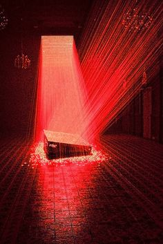 V is name from the shape of the laser beams that they are beamed down from a laser board. This installation is by Li Hui at The Chapel space of the Singapore Art Museum which he created atmospheric environments with lasers and light,