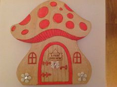 Magical hand painted and decorated mushroom fairy door by Karensdoings on Etsy
