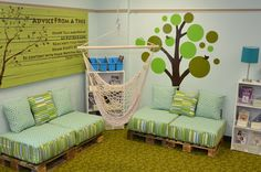 Reading corner in classroom made from recycled pallets. LOVE the hanging swing!! The other pics of this girl's classroom are great too