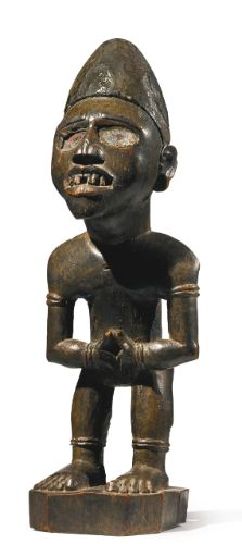 dogon and kongo power figure The large standing statue of a man bristling with nails & blades is a kongo power figure (nkisi n'kondi)  seated couple, dogon, mali, ca 1800-1850,.