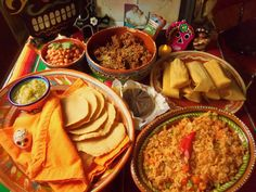 Some of the food that is given to the deceased is tamales, tortillas, rice, breads, chocolates, salsa, candies, and anythings else the deceased liked to eat.