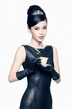 Yang Ying or Angelababy does a Audrey Hepburn look in leather dress and leather gloves.