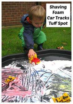 Shaving Foam is a brilliant resource to use and relatively cheap too. Although Adam isn& a fan of touching the shaving foam he will do if cars are involved. We created a Shaving Foam Car Tracks Tuff Spot to explore the shaving foam and paints. Eyfs Activities, Nursery Activities, Infant Activities, Activities For Kids, Tuff Spot, Baby Sensory, Sensory Bins, Sensory Play, Tuff Tray Ideas Toddlers