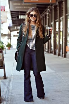 flared jeans with striped top, and overcoat