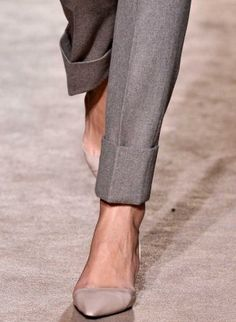 I WANT and LOVE these pants! Ankle pant with cuff = kick ass. That can be a classy look or make it bad ass but either way it works!