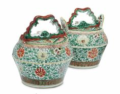 A pair of Chinese famille verte watering pots and covers, second half 17th…
