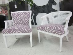 white cane chairs and purple zebra print