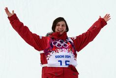 Bronze Medallist, Canada's Kim Lamarre celebrates during the Women's Freestyle Skiing Slopestyle Flower Ceremony at the Rosa Khutor Extreme Park during the Sochi Winter Olympics on February 11, 2014.
