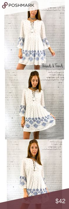 White Boho Lace Up Dress Gorgeous white boho baby doll dress featuring a blue medallion print throughout the garment. Features a lace Up detail. Very on trend and Beautiful for spring. Double lined and isn't see  through at all. Very high end quality.  Measurements: Small  Bust 40 Length 34  Medium Bust 44 Length 35  Large  Bust 46 Length 36  Fabric content: rayon Dresses