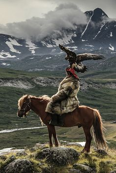 Shohan, a Kazakh Eagle Hunter, Altai Mountain Range,  Mongolia. This is where some Kazakh Nomads spend their Summer. | Lisa Vaz