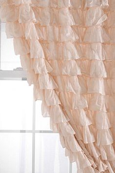 Ruffle curtains. I kind of like this color for the kitchen. It may look good with my grey walls. -kp