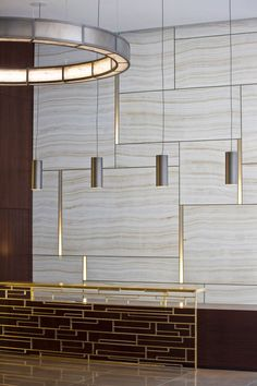 stone and brass contemporary lobby -