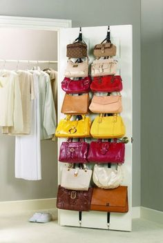 There's ample storage space hiding on the other side of your closet door. Use it strap in your band of purses.