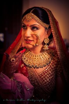 Bridal Portrait - Gold Wedding Jewelry   WedMeGood   Red Lehenga with Red and Gold Choli, Gold Choker Necklace with Matching Matha Patti and Nath #wedmegood #indianbride #indianwedding #bridal #jewelry #indianjewelry #choker #nath #mathapatti #red #gold  Photo by: Karan Singh Sidhu For more such inspiration, visit www.wedmegood.com