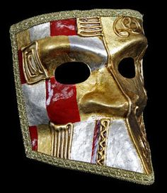 An excellent full face Bauta venetian mask finished in stunning silver, gold & red all edged with gold brocade...Stunning and very traditional mask. Ideal mask for men but of course can be worn by ladies too. With traditional black satin ties, for a comfortable fit, this Venetian mask is perfect for your next Venetian masquerade party.