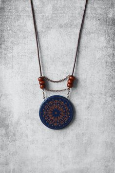 Blue mandala necklace for her with brown handmade lines pendant, leather cord & red beads - polymer clay boho / hippie style jewelry- handmade unique trends and finds - trendy jewellery - beautiful gift for woman  by AnankeJewelry  anankejewelry.etsy.com Kollier | Halskette | Kollier | Collana | Colar  | Kолье | Collar | Gargantilla | halsband | 项链 |