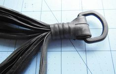 Recycled inner tube plant hanger - tie gathering knot   Bicitoro Bikes & Crafts