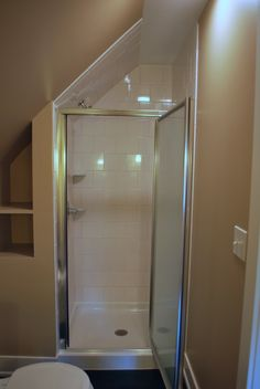 Half wall for attic shower - idea: add glass shelves in wasted space to the left of shower wall.