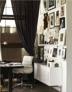 Love this art display and the black and white office!